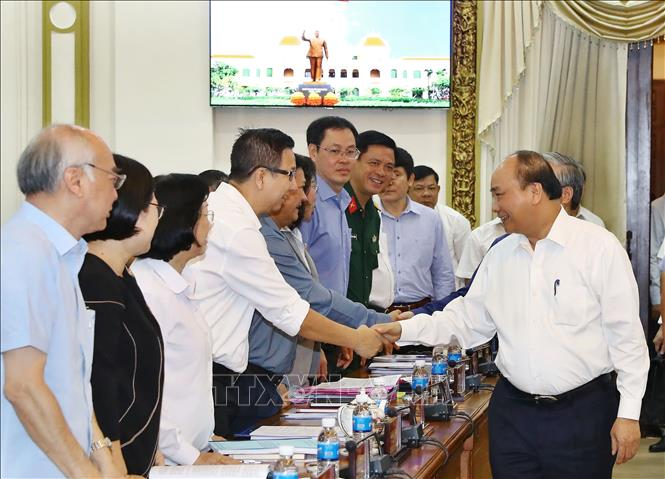 Photo: PM Nguyen Xuan Phuc and the delegates at the conference. VNA Photo: Thống Nhất
