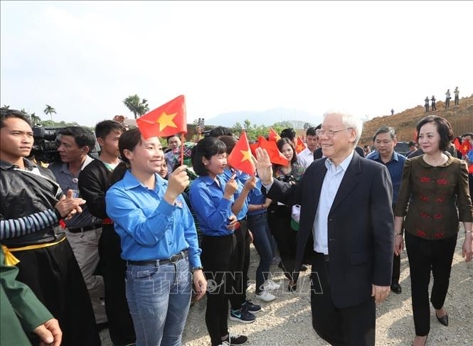Photo: Party General Secretary, President Nguyen Phu Trong (R) attends the Tree Planting Festival. VNA Photo: Trí Dũng