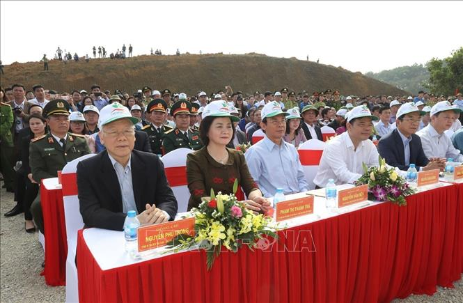 Photo: Party General Secretary, President Nguyen Phu Trong (L) attends the New Year Tree Planting Festival. VNA Photo: Trí Dũng