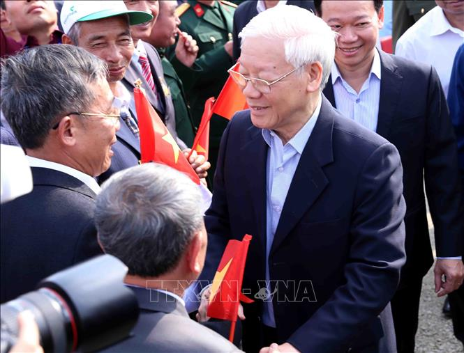 Photo: Party General Secretary, President Nguyen Phu Trong (R) attends the New Year Tree Planting Festival. VNA Photo: Vũ Sinh