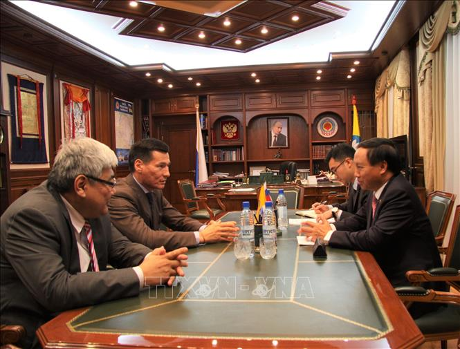 Photo: Ambassador Ngo Duc Manh (R) has talks with President Batu Khasikov. VNA Photo: Duy Trinh