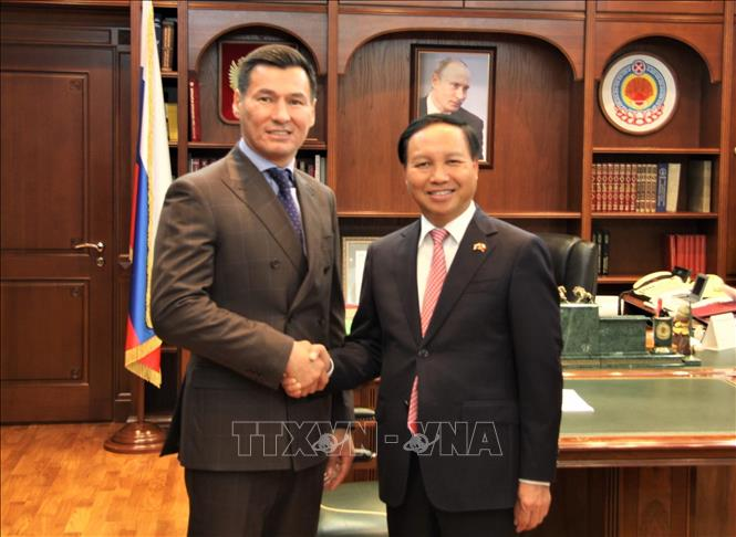 Photo: Ambassador Ngo Duc Manh (R) and President Batu Khasikov. VNA Photo: Duy Trinh