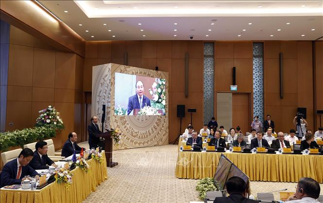 Photo: PM Xuan Phuc speaks at the video conference. VNA Photo: Thống Nhất